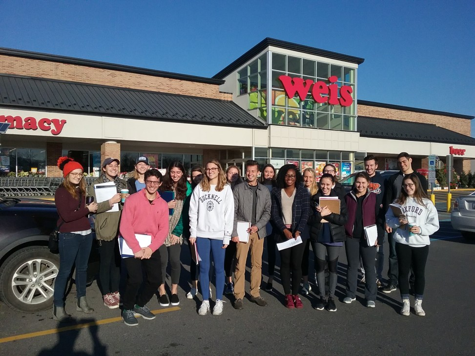 students in front of supermarket