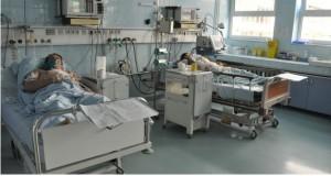 bolnavi in pat de spital
