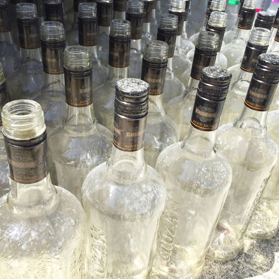 Peeled rum bottles