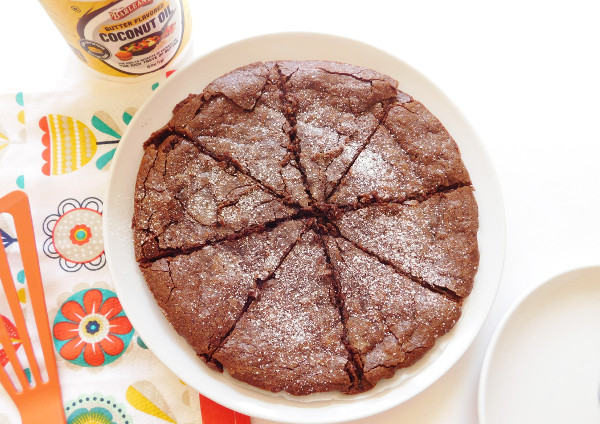 A baked Swedish Sticky Chocolate Cake on a plate cut and ready to eat.