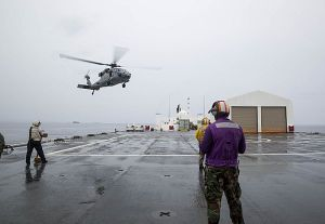 150630-M-DN141-519 ARAWA, Autonomous Region Of Bougainsville, Papua New Guinea (June 30, 2015) An MH-60S Sea Hawk helicopter from Helicopter Sea Combat Squadron (HSC) 21 returns to the Military Sealift Command hospital ship USNS Mercy (T-AH 19) from a mutual aid request with six patients to be treated aboard the ship. The helicopter transported the six passengers, including one infant, from Han Island after a mutual aid request during the second port mission of Pacific Partnership 2015 in Papua New Guinea. Pacific Partnership missions to date have provided medical care to approximately 270,000 patients and veterinary services to more than 38,000 animals. Additionally, the mission has provided critical infrastructure development to host nations through more than 180 engineering projects.(U.S. Marine Corps photo by Sgt. Valerie Eppler/Released)