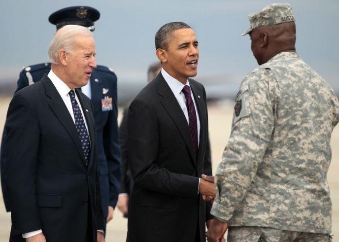 President Obama (center) and Vice President Joseph R. Biden Jr. (left) greet Gen. Lloyd Austin, the top U.S. commander in Iraq, on the apron at Joint Base Andrews outside Washington on Tuesday, Dec. 20, 2011. (AP Photo/Carolyn Kaster)