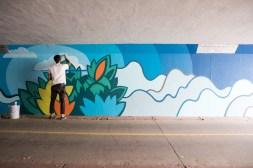 David Polka at work on Moorhead Ave. mural