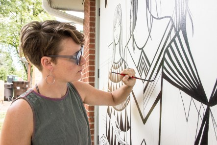 Lindee Zimmer at work on a new mural