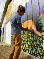 Chris Huang painting a mural