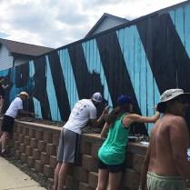 Workshop8 painting a mural for Creative Neighborhoods