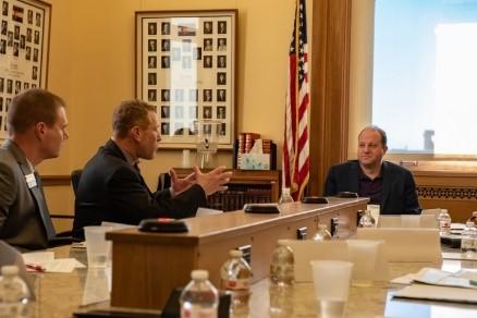 Boulder Chamber President John Tayer speaks with Governor Jared Polis