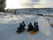 Local children sledding.