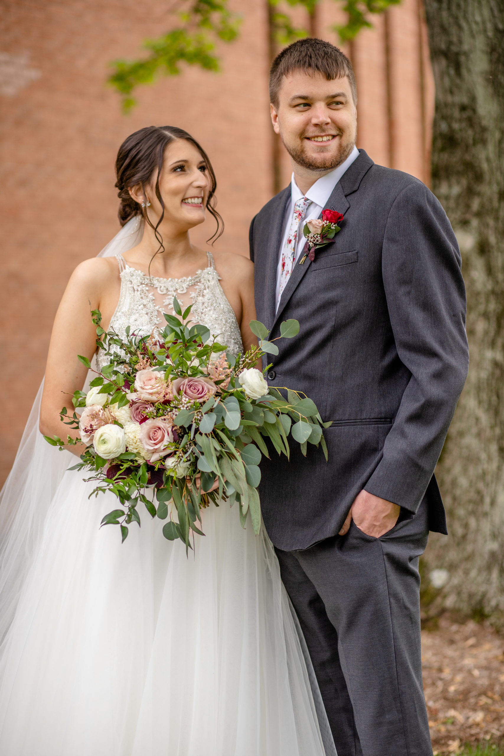 bouquet, bride and groom, wedding dress, hair bun, grey suit, red rose boutonniere, southern illinois photographer