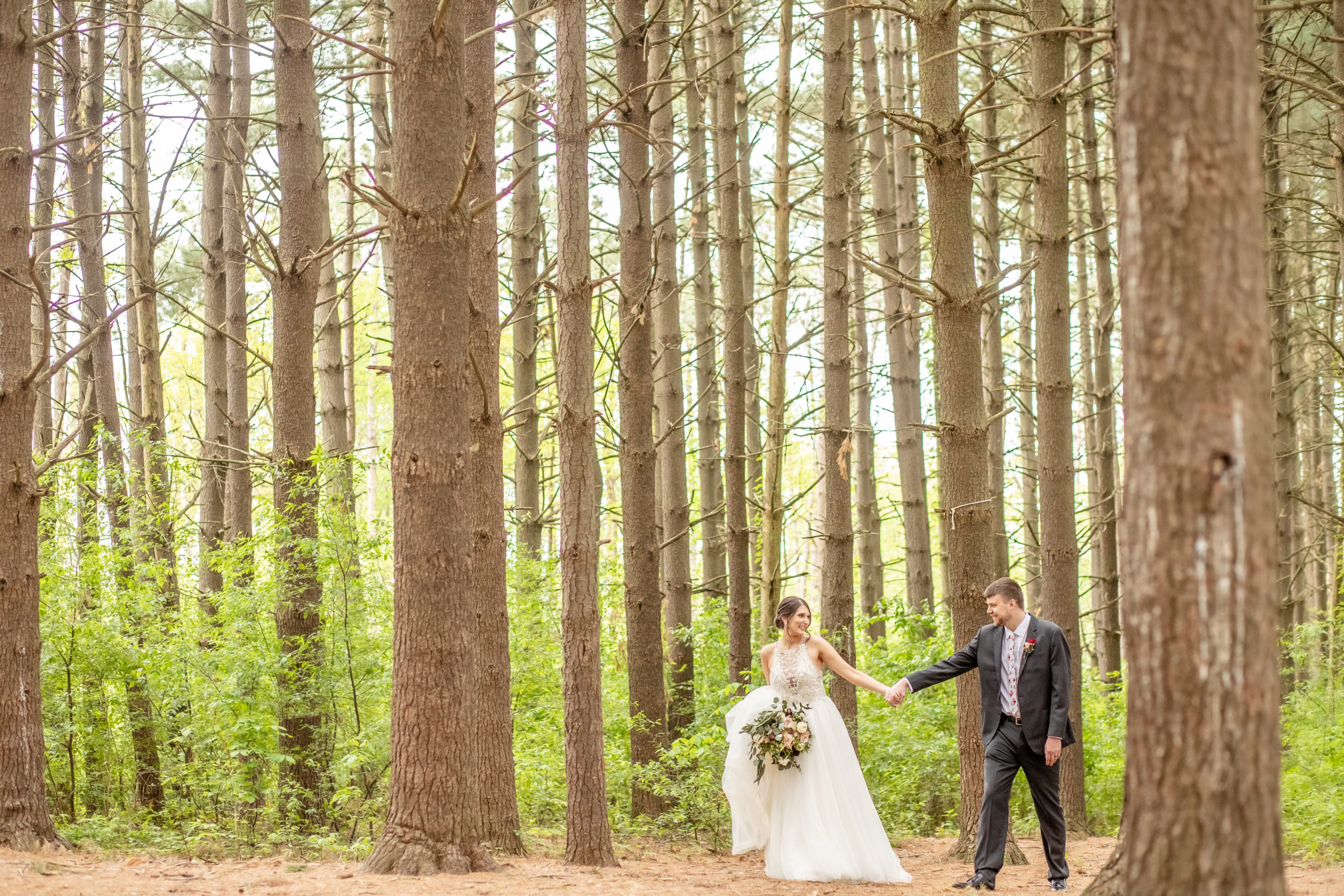 bride and groom, hand in hand, pine trees,southern illinois photographer