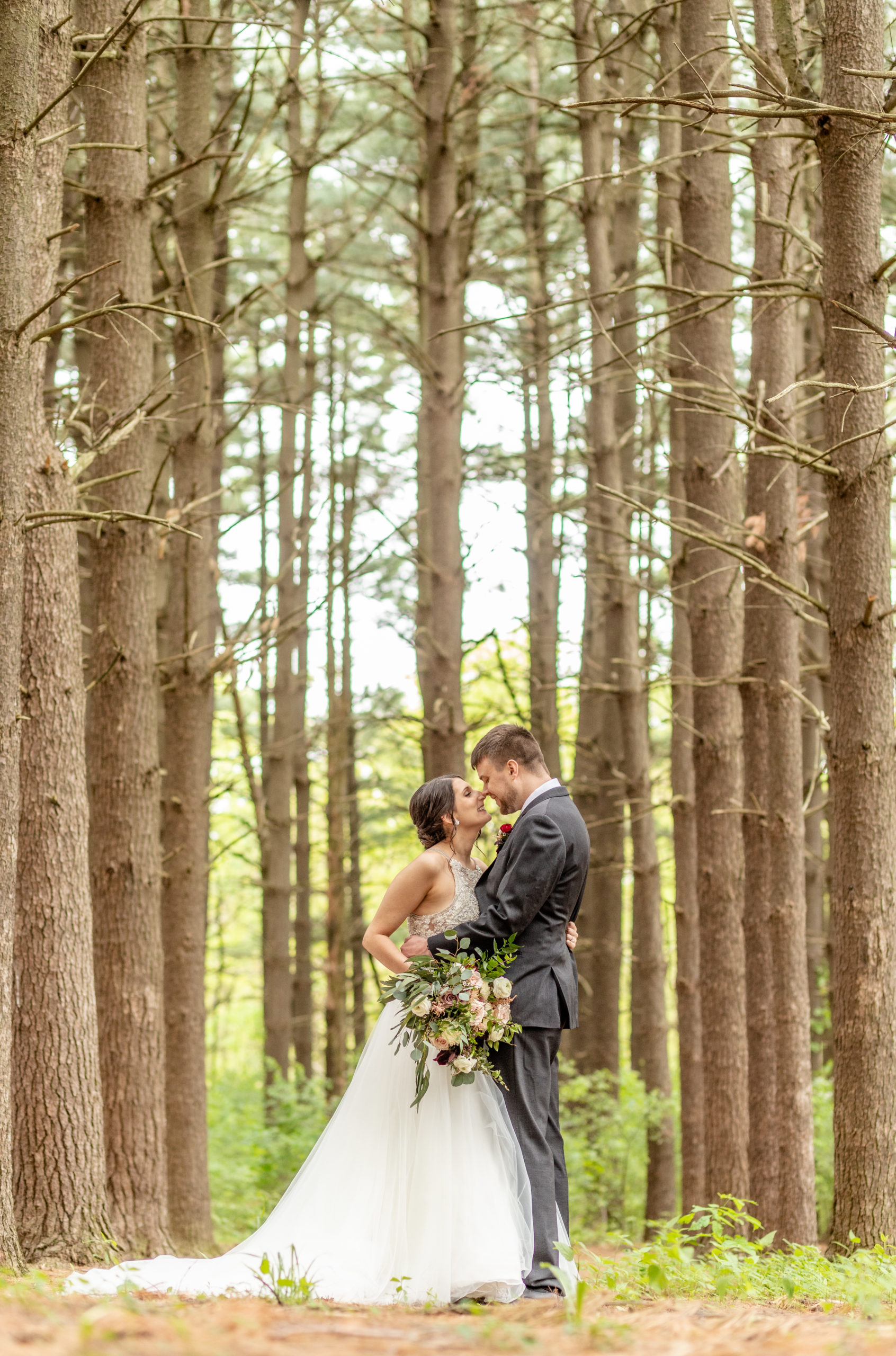 laughing under the trees, bride and groom, wedding day, pine trees, southern illinois photography