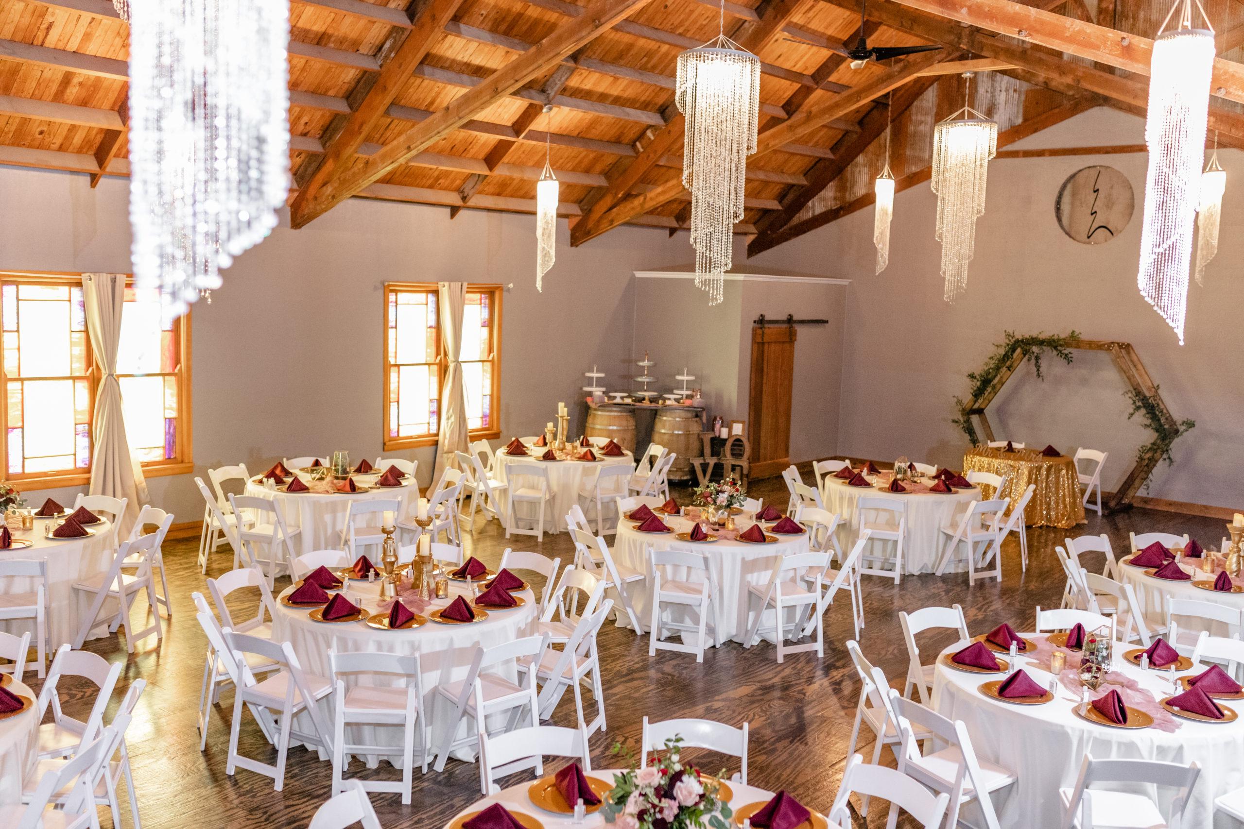 reception hall, rustic, chandeliers, maroon,