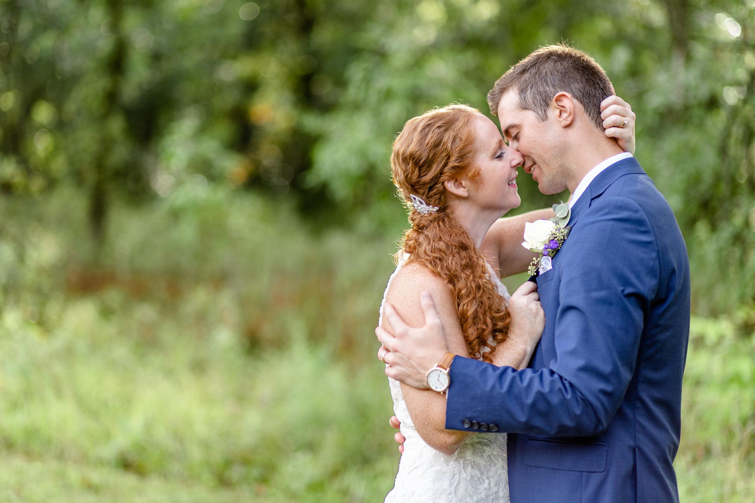 wedding photography, summer romance wedding, purple wedding accents, southern illinois wedding photography, bride and groom romantic kiss, lakeside wedding, woodland romance, woodland wedding