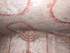 Menorah symbol inside catacomb