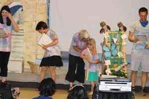 Boulder JCC Pre-K Owl receives her diploma from teacher Caroline Saliman.