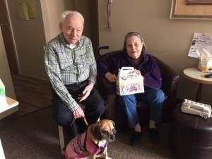 JFS Friendly Visitor volunteer Anita Simon delivers a Purim basket to Max Goldberg.
