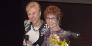 Menorah and Boulder Jewish Film Festival Executive Director Kathryn Bernheimer is presented flowers by Menorah program director and past president Susan Litt.