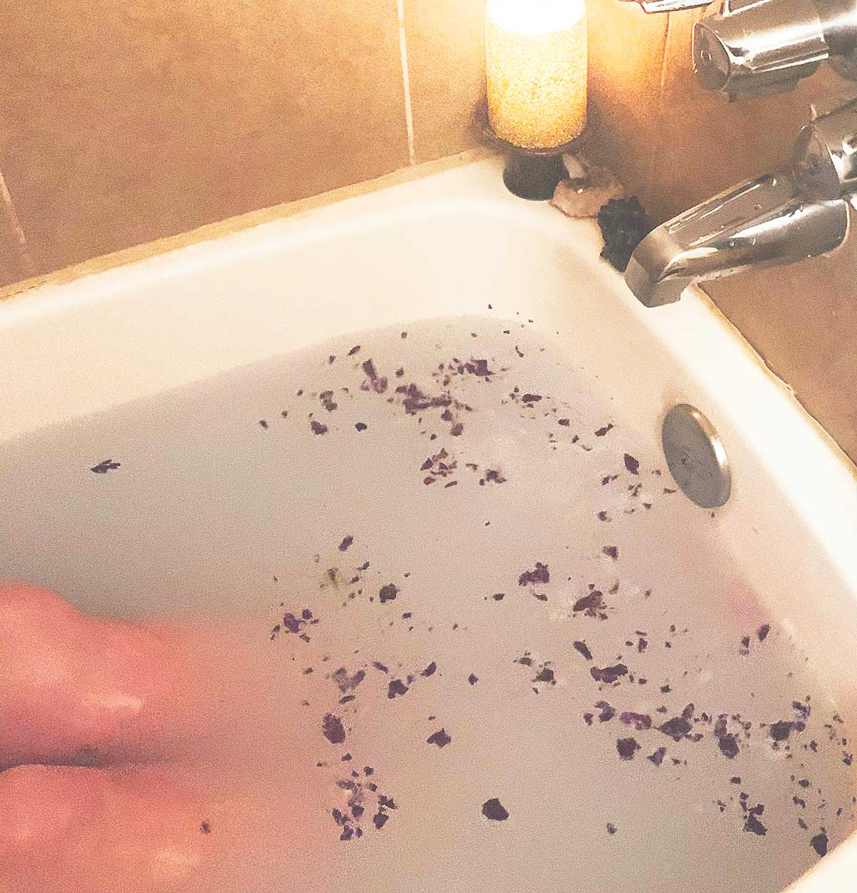 dawn in tub with crystals and roses