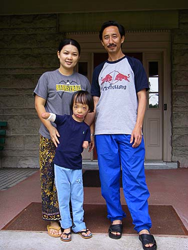 Noi, Boun Lod, and Via at the Shriners Parent House after Boun Lod's surgery.