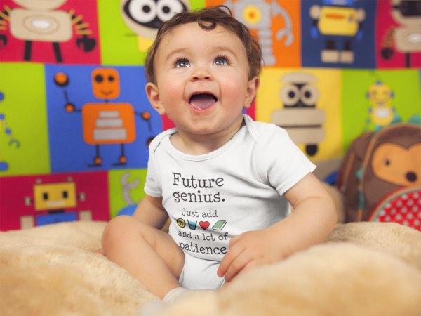 Baby boy wearing Future Genius onesie