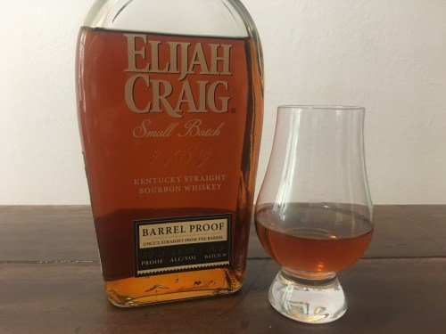 Bottle of Elijah Craig barrel proof with glencairn glass on table
