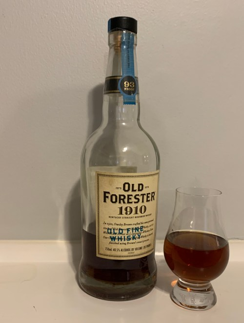 Bottle of Old Forester 1910 with glencairn glass