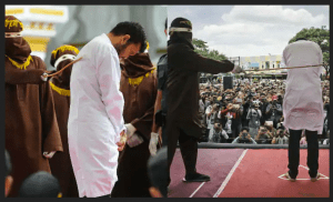 Indonesian Men Publically Caned For Gay Sex Acts Defying Sharia Law!