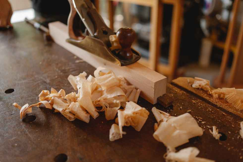jack plane and wooden plank on table
