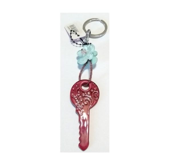 Porte clés motif clé violet