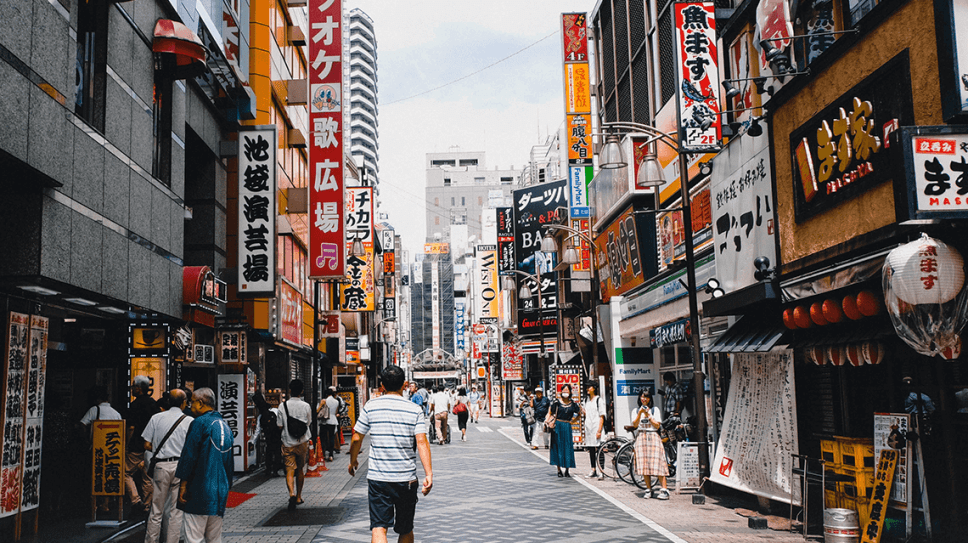 A bustling street with lots of Japanese signs in Tokyo, Japan