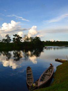 cruising Peru's Amazon river during sunset