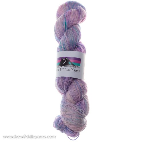 Skein of pale blue and pink white nep yarn