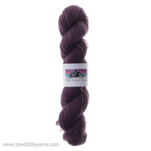 Tonal hand dyed skein of Aird 150g superwash merino yarn in aubergine