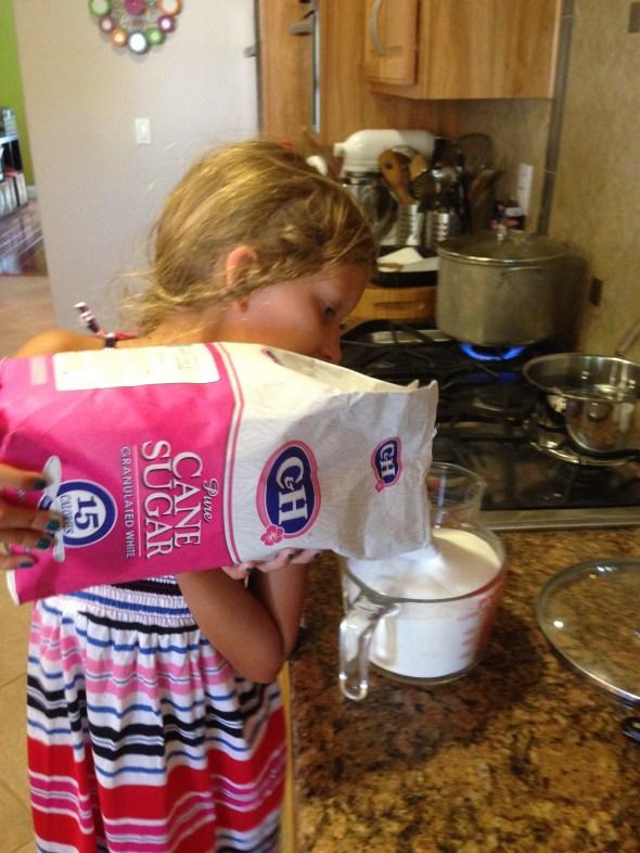 Measuring the sugar.