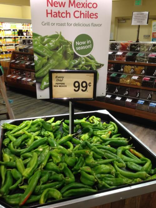 A pile of hatch green chiles at the grocery store.