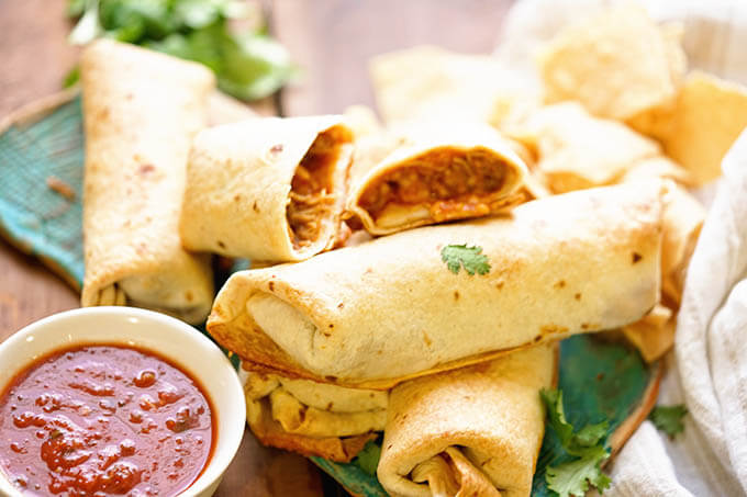Easy Chimichanga Recipe served on a blue platter with salsa