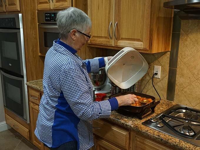 Mom basting the sweet potatoes