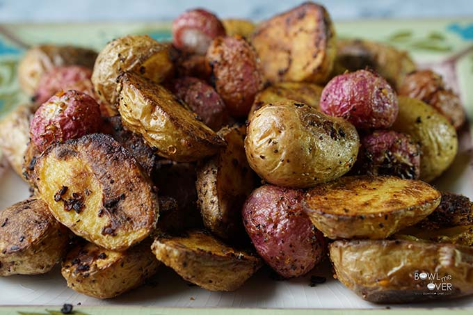 Roasted Potatoes and radishes on green platter.