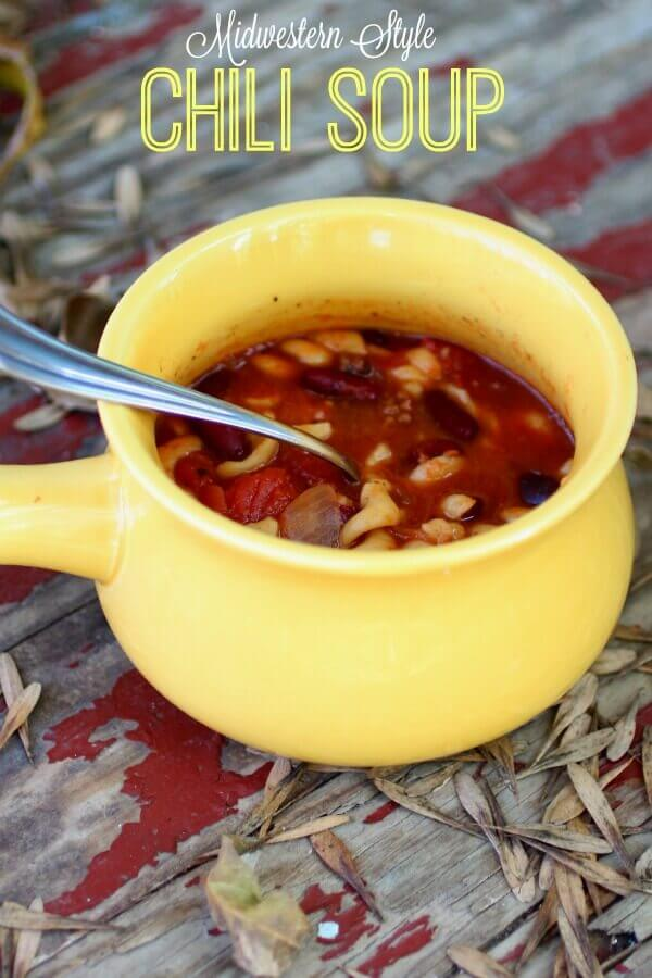 A yellow mug filled to the brim with midwestern style chili.