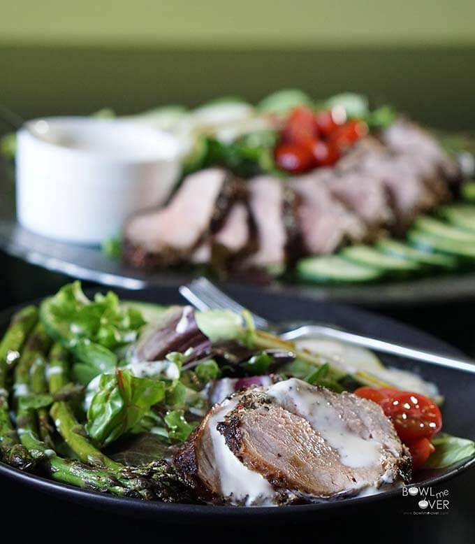 Pork Tenderloin Salad on greens with creamy dressing.