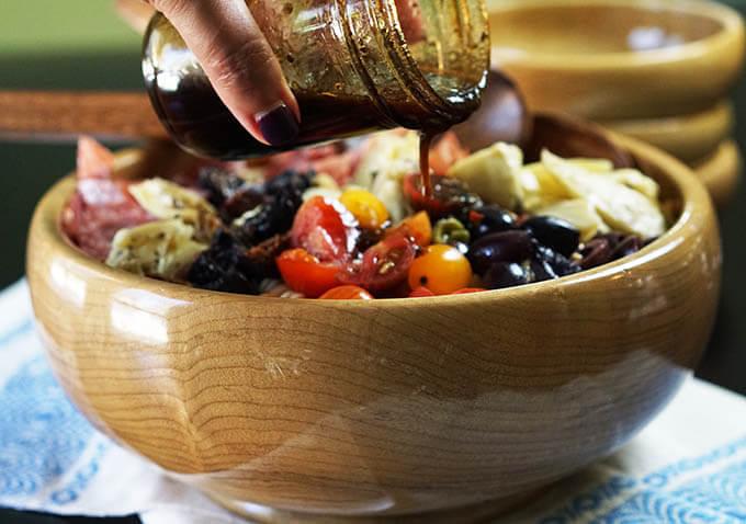 Homemade Balsamic Vinegar Salad Dressing poured over antipasto salad