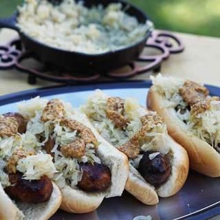 Beer brats on platter with sauerkraut