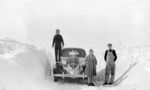 Car in snowdrifts with family