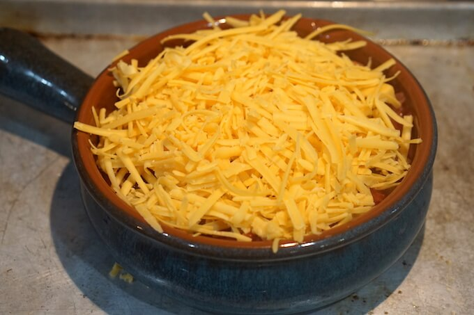 Step three Now shredded cheddar cheese has been added to the beans.