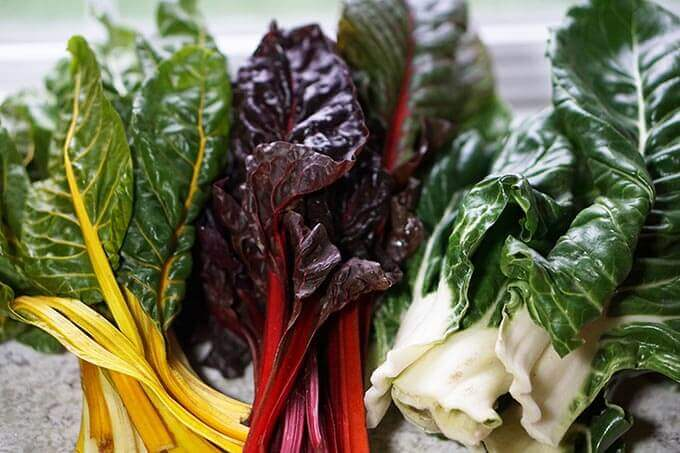 Three different types of Swiss chard, yellow, red and white.