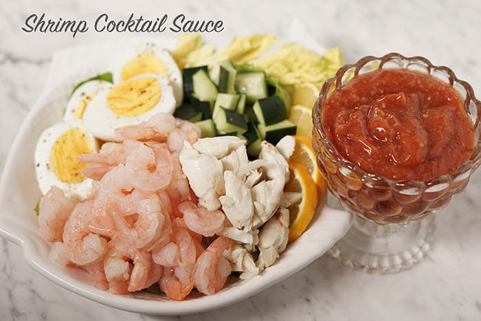 A plate of seafood, crab, eggs and cucumbers with red cocktail sauce. #ShrimpCocktailSauce #BowlMeOver