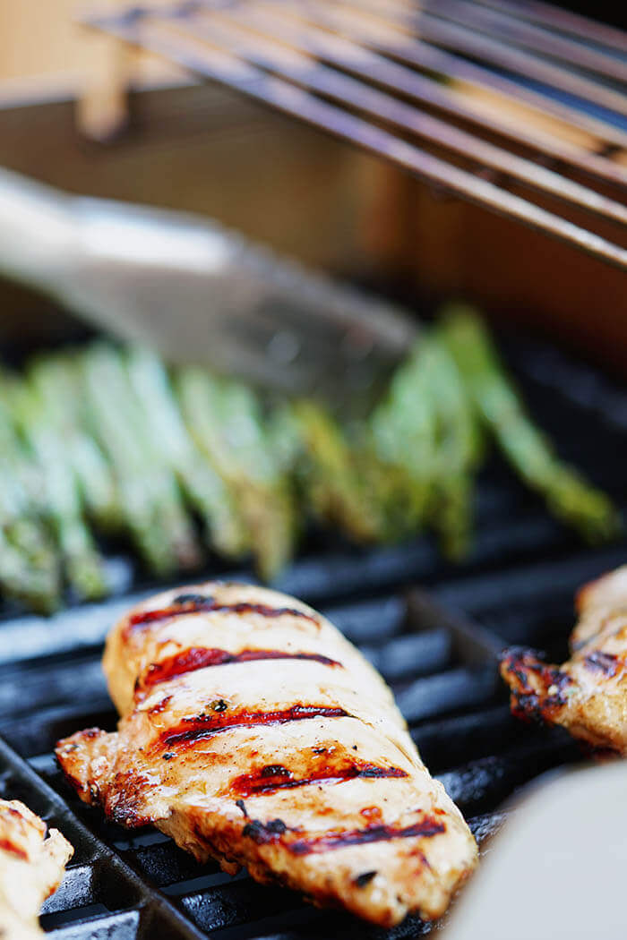 Chicken on the grill with lemon pepper marinade and asparagus
