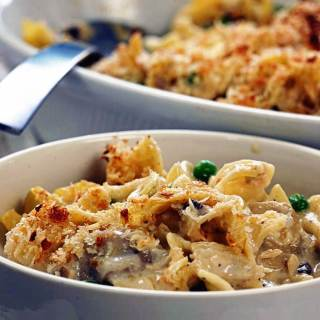 Tuna Casserole fills up a white bowl. There's a serving dish with a spoon for more when you're ready for seconds.
