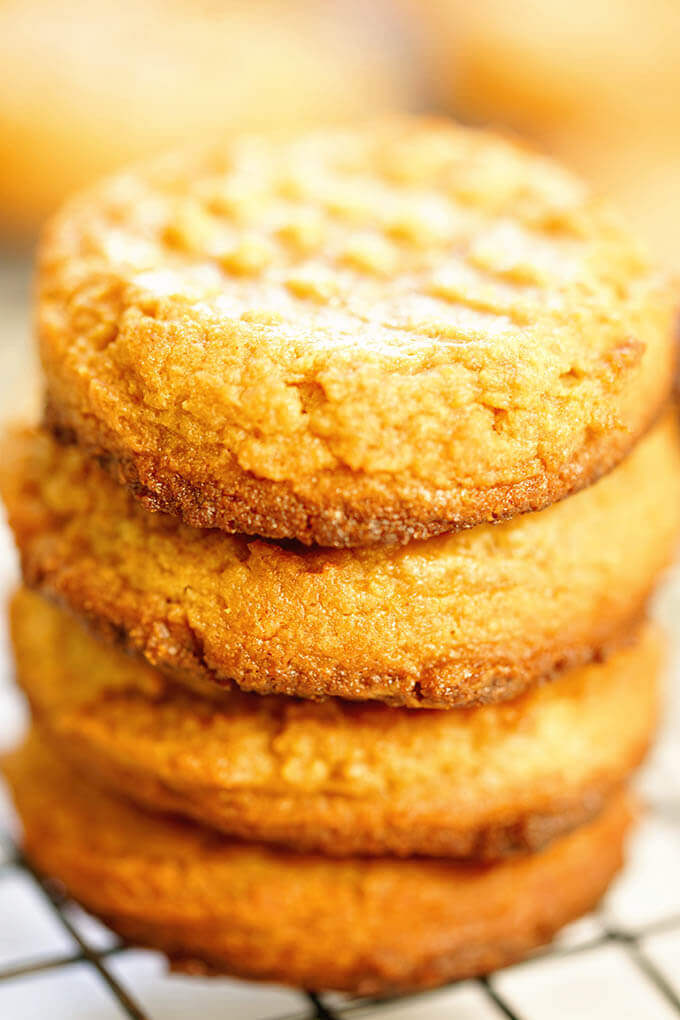 A stack of 4 Ingredients Peanut Butter Cookies on a cooling rack.
