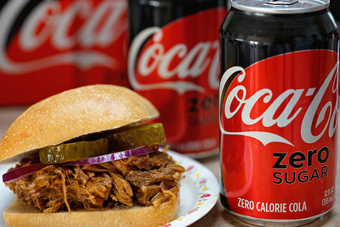 Pulled Pork Instant Pot surrounded by Coca-Cola
